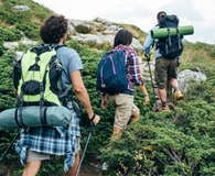 Friends hiking with backpack tents