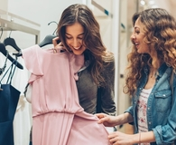 Woman buying clothes to keep up with the Joneses