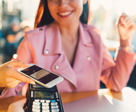 Girl in cafe making mobile payment