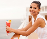 Girl relaxing on cruise drinking cocktail