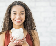 Girl with piggy bank in her hands