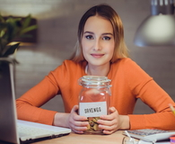 Girl with savings jar