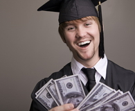 Graduation student with money in his hands