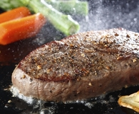 Using best electric griddles to grill steak dinner