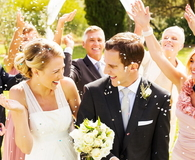 Guests Throwing Confetti On Couple During Reception