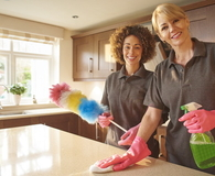 Happy professional cleaning team