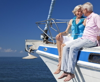 Happy Senior Couple Sitting on a Sail Boat