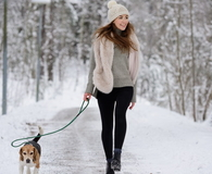 Happy woman walking with beagle dog