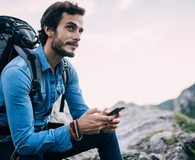 Hiker using mobile