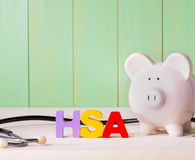 HSA theme with stethoscope and a piggy bank