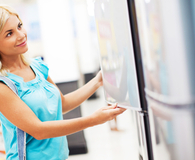 Woman asking questions before buying a refurbished appliance