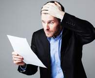 Man learning what to do when a tax preparer makes a mistake