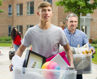 College student bringing dorm essentials that make life easier