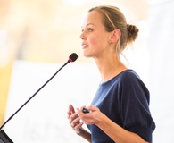Woman making public speaking less terrifying