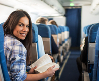 Woman making her next flight more comfortable