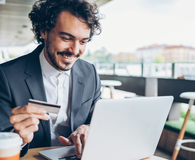 Man turning credit card rewards into real wealth