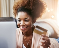 Woman wondering if she should pay bills with a credit card