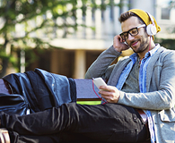 Man listening to audiobooks about money