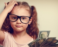 Kid learning frugal living skills parents didn't teach her