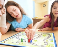 Kids playing fun games that teach them about money