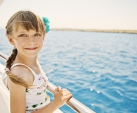 Little girl on cruise vacation with family