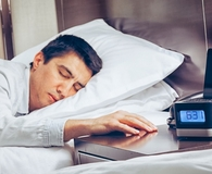 Man using best smart alarm clocks to wake up
