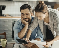 Man and woman home budgeting