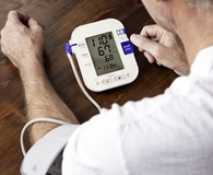 Man using best blood pressure monitor