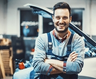 Man saving money with car maintenance checklist