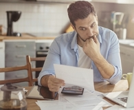 Man learning to beware of common debt consolidation traps