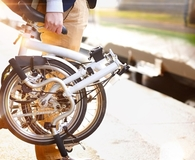 Man using best folding bicycle on his commute