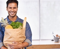 Man using grocery shopping tricks that make his life easier