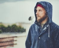 Man getting best rain jacket for men