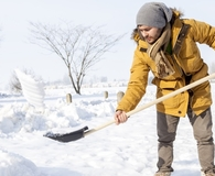 Man using best snow shovel