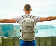 Man wearing daypack while traveling