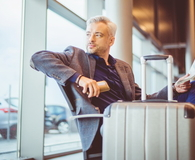 Mature businessman waiting at airport lounge