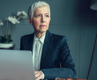 Mature Businesswoman Portrait In Her Office