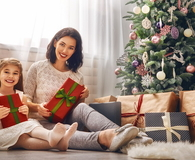 Mother and daughter exchanging gifts