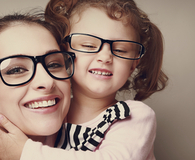 Mother and daughter wearing glasses with biggest markup