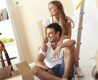 Young couple packing their belongings and should have hired movers