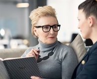Woman mentoring younger woman at work
