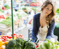 Woman shopping for organic produce that is not just labeled organic