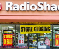 Radio Shack store entrance facade with closing sale sign