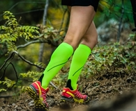 Woman wearing the best compression socks while running