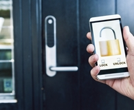 Man using best smart lock on front door