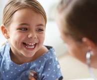 Smiling little girl with a doctor