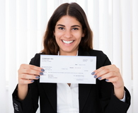 Successful Businesswoman Showing Check