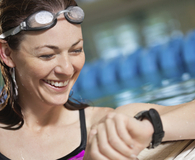 Woman using best underwater watch during swim