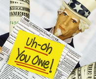 Uncle Sam with Warning that You Owe Taxes