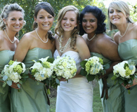 Women in bridesmaid dresses with bride at wedding